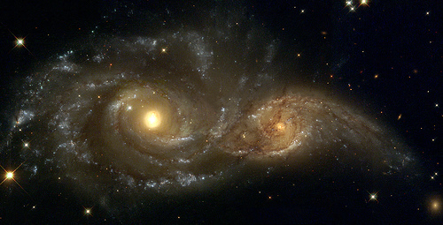 A Grazing Encounter Between Two Spiral Galaxies (NGC 2207 and IC2163)