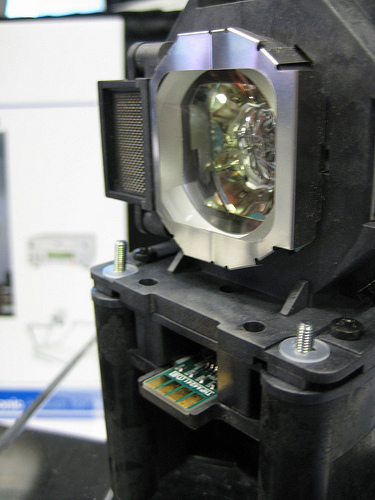 Panasonic PT-F100NT Lamp showing on-board chip that keeps actual lamp hours with LAMP not projector