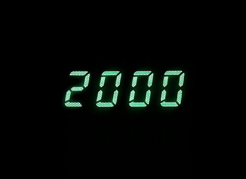 Horizontal green digital 2000 millenium display clock memories b