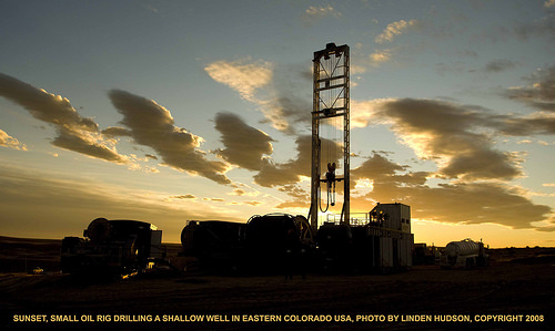OIL RIG IN COLORADO, USA, BEAUTIFUL SUNSET