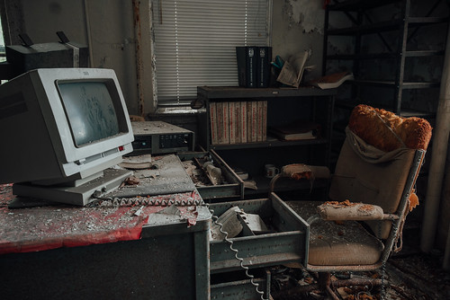 A silent office with dusted computer