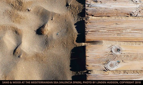 SAND & WOOD ON BEACH IN SPAIN