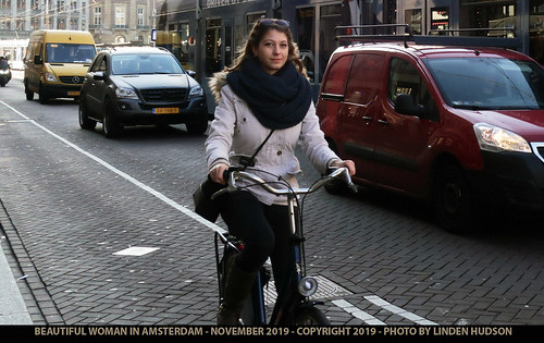 BEAUTIFUL AMSTERDAM WOMAN ON BICYCLE - 2019